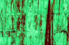 Old rusty greenish-reddish iron wall background. Partially restored, fragile, left over, cool optic. This image is part of a collection of different color Stock Images