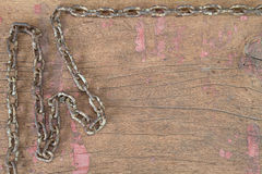 Old rusty grunge chain on vinatge grunge wooden background. In vintage style Stock Photo