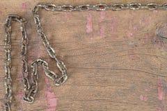 Old rusty grunge chain on vinatge grunge wooden background Stock Photo