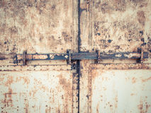 Old rusty grunge iron gate and padlock Stock Photography