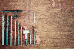 Old rusty grungr drill bits on vintage grunge wooden background Stock Photo