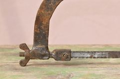 Old rusty hacksaw. Macro detail of old rusty hacksaw. Carpentry, carver Stock Images