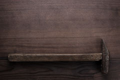 Old rusty hammer on wooden background Royalty Free Stock Photo