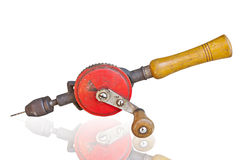Old rusty hand drill on white background. Stock Image