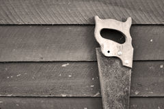 Old rusty hand saw. Leaning against a wall Royalty Free Stock Photo