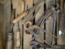 Old rusty hand tools. In a wooden box royalty free stock images