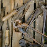 Old rusty hand tools. In a wooden box royalty free stock image