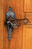 Old rusty handle in door Stock Photos