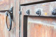 Old rusty handle on a wooden door Stock Photos