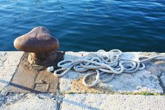 Free Old Rusty Harbor On Boat Pier With Sea Rope In Pula. Royalty Free Stock Photos - 143930268