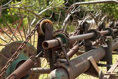 Old rusty Hay Turner.  Old agricultural equipment on hay. Stock Photos