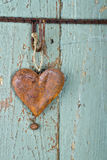 Old rusty heart on wooden background Stock Photo
