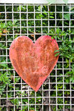 Old Rusty Heart On Wooden Background Stock Images