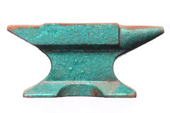 Old rusty green anvil  isolated. Old rusty heavy steel green anvil  isolated on white background Royalty Free Stock Photos
