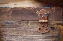 Old rusty hinge. On a big old hardwood frame or a tool box stock images
