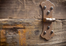 Old rusty hinge. On a big old hardwood frame or a tool box Stock Photo