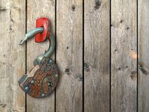 Old, rusty hinged lock. Stock Photos