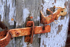 Old rusty hinges on wood door Royalty Free Stock Photos