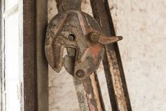 Old rusty hoist. At building site royalty free stock photo