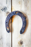 Old rusty horseshoe hanging on a nail Stock Photo