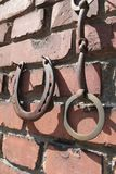 Old rusty horseshoes and bridles Stock Photo