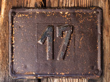 Old rusty house number Stock Images