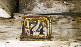 Old rusty house sign number 74 Royalty Free Stock Photography