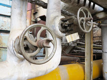Old rusty industrial pipe valve for hot water at power plant Royalty Free Stock Photography