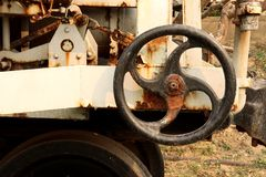 Old and rusty industrial pipe valve at power plant, Metalworking industry : gear wheel machine stock photo