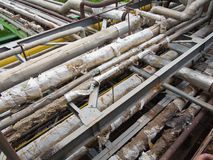 Old rusty industrial steel pipelines, valves and equipment at po Royalty Free Stock Images