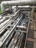 Old rusty industrial steel pipelines, valves and equipment at po. Wer plant Stock Photo