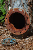 Old rusty industrial tap water pipe and valve.  Royalty Free Stock Photography