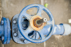 Old rusty industrial tap water pipe and valve Stock Photography