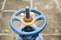 Old rusty industrial tap water pipe and valve Royalty Free Stock Photo