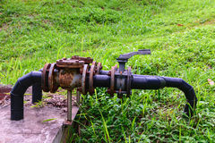 Old rusty industrial tap water pipe and valve Royalty Free Stock Images