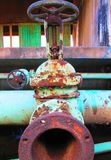 Old rusty industrial green pipe valve to be replaced Stock Image