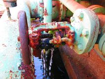 Old rusty industrial green pipe valve to be replaced Stock Images