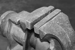 Old rusty iron bench vise on workbench close-up Royalty Free Stock Image