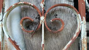 Old rusty Iron cast on wooden  fence Stock Photo
