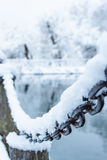 Old rusty iron chain on a frost covered with snow Royalty Free Stock Image
