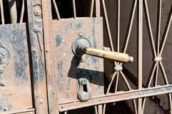 Old rusty iron door handle close up shot Stock Image