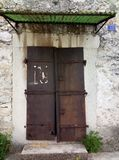 An old rusty iron door in an old house royalty free stock photography