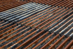 The old and rusty iron roof of a building Stock Image
