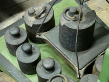 Old rusty iron scale weights. Stock Photo