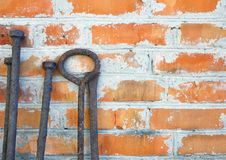 Old rusty iron scrap standing on the background of a brick wall. For your design stock photos