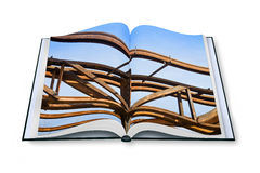 Old rusty iron structure - Opened photobook on white b. Ackground stock photography