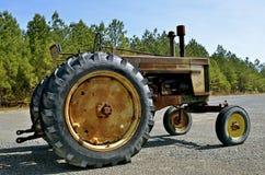 Old rusty John Deere tractor. AMITY, ARKANSAS, April 7, 2017: The old rusty parked 720 John Deere tractor is a product of John Deere Co, an American corporation Stock Photography