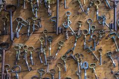 Old rusty key collection pattern royalty free stock photography