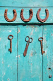 Old rusty  key and luck symbol horseshoe on wooden farm wall Royalty Free Stock Photos