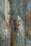 Old rusty keyhole in a weathered old wooden blue door Royalty Free Stock Images